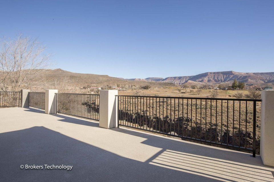 Unbelievable views of mountains,& Ash Creek included with purchase of beautiful custom home. The unfinished basement provides additional square footage. Windows,deck & patio take full advantage of amazing views. Large 1.26 acre lot provides privacy. Additional 24\