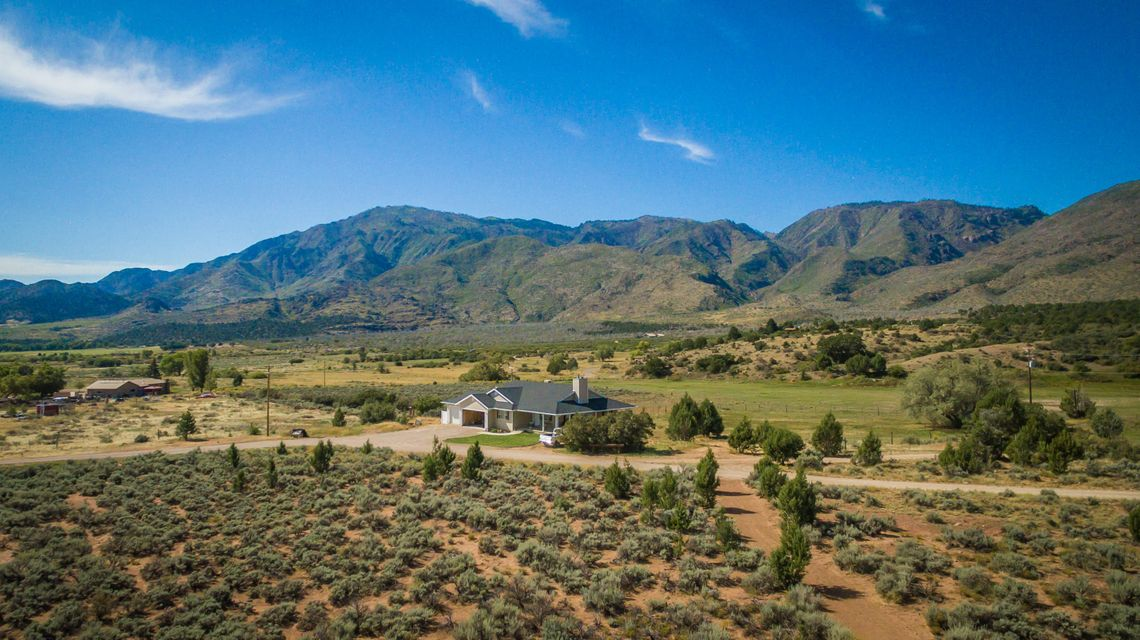 Own your own ranch in Meadow Springs... Endless possibilities. These properties back to Dixie National Forest. The views of Kolob Fingers are breath taking. Two residences (2nd home was built in 2004 - 1691 sf upstairs with 2 bedrooms & 2 bathrooms, 3 car attached garage & 1691 sf unfinished basement) and two springs are included. Property is almost fully fenced, ride ATV\