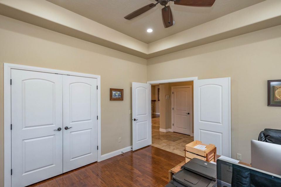 Nicely upgraded home with 4 bedrooms, 2.5 baths and a 3 car garage. Beautiful Wood & travertine floors, granite countertops, custom cabinets and stainless steel appliances. The middle bedroom has a Murphy bed that stays and also the built in counters in garage will stay as well. Must see!