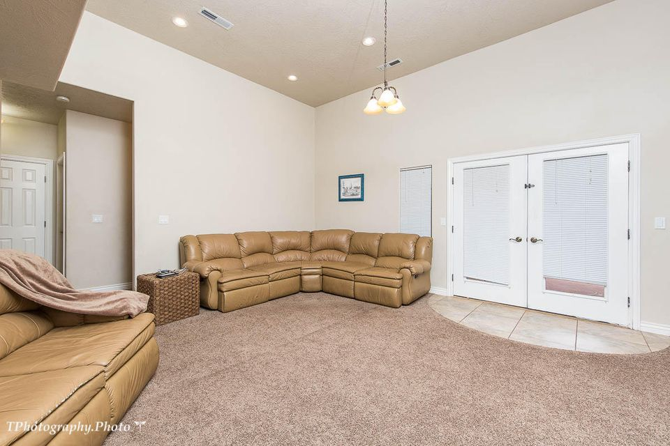 This 4 bedroom 2 bathroom home has a great open floor plan, lots of storage, 3 car garage, close to schools and walking trails.  Enjoy the beauty of Snow Canyon in surrounding areas.  Call Agent for an appointment to view.
