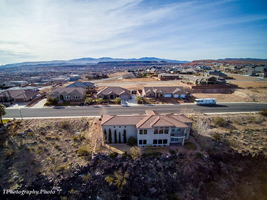 This executive style home is perched high above East St. George on Foremaster Ridge. This home features incredible views of Zion National Park and Pine Valley Mountain. The home has been used lightly as a second home over the last 8 years. Main level features an open living room and kitchen combination with granite counters,8\
