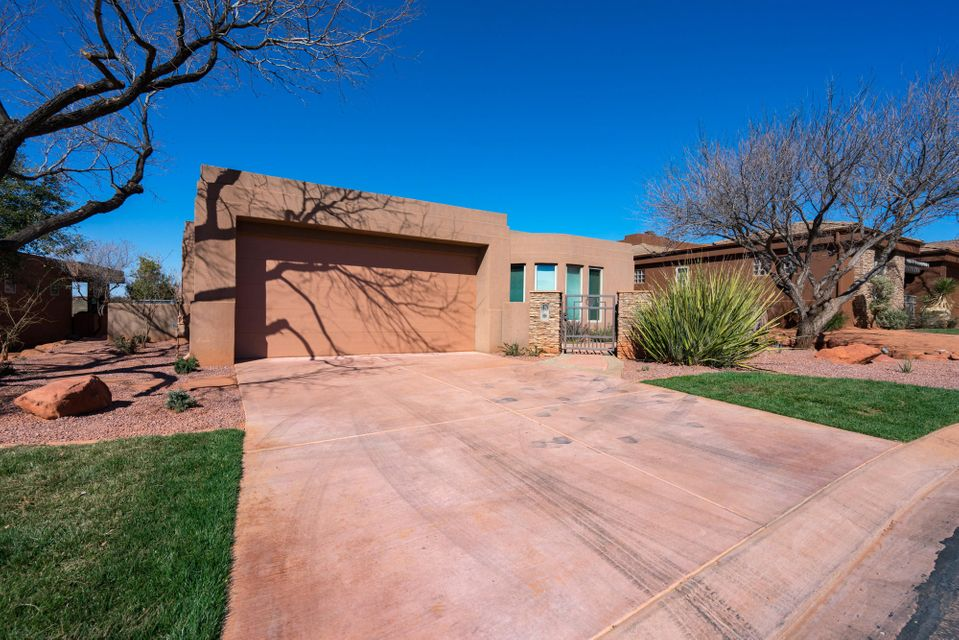 Fabulous Entrada home in Paiute Springs.  Unobstructed views of Snow Canyon and hole #3!  Home features a hot tub with waterfall, 2 bedrooms, 2 bathrooms, slate tile floors and more!  Call to show!