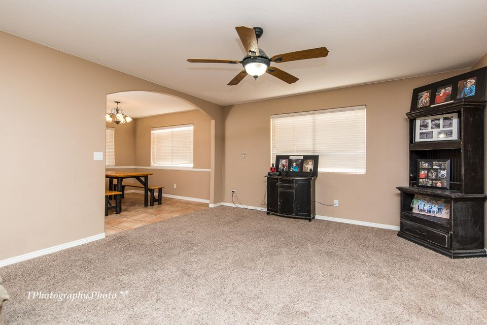 Great home for the square footage. Open living room & kitchen with a fireplace & tile floors. Home comes with a 3 car garage plus a workshop with power, RV parking with full RV hook-ups. Great yard for your kids, dogs and everything else! Granite tile counters, separate dining area, separate jacuzzi tub and shower in master bedroom. Deck off of master bedroom.Within walking distance to Harmon\