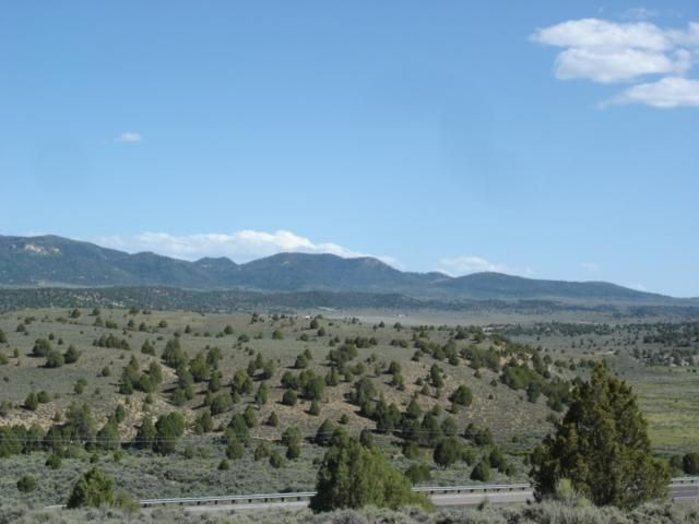 Lot #4. Fabulous views of Long Valley, surrounding mountains and Asay Creek! Conveniently located halfway between Bryce and Zion National Parks on Scenic Highway 89 between mile markers 112 and 113 just 3 miles south of the town of Hatch in Pinyon Hills Estates. Great wooded lot(s) overlooking magnificent pink cliffs that frame the Sevier River valley. Newly improved road and underground
