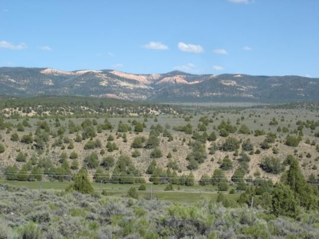 Lot #6. Fabulous views of Long Valley, surrounding mountains and Asay Creek! Conveniently located halfway between Bryce and Zion National Parks on Scenic Highway 89 between mile markers 112 and 113 just 3 miles south of the town of Hatch in Pinyon Hills Estates. Great wooded lot(s) overlooking magnificent pink cliffs that frame the Sevier River valley. Newly improved road and underground