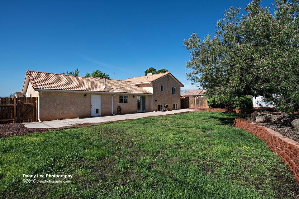 4 BR, 2 Bath Home, 2 car garage, Living & Family rooms, large fenced backyard with eye stunning views of Red Mtns & large cement patio.  Over the past 30 days the home has been remodeled which includes brand new: Whirlpool dishwasher; Kohler, 18 gauge, stainless kitchen sink and faucet; range hood; garage door opener; luxury vinyl plank & laminate flooring throughout; redone cabinets & hardware;