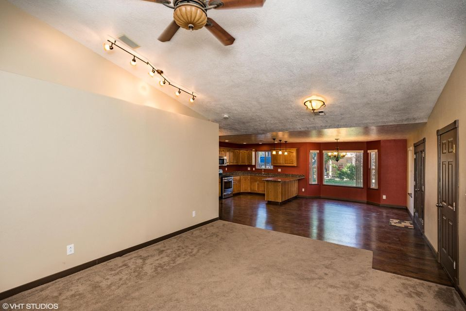 Amazing remodeled home with unbelievable backyard and entertaining areas, featuring a waterfall, professionally installed fire ring, hot tub area with pergola, huge covered outdoor kitchen entertaining area, paths, shade, and playground.  Large lot includes rear open parking area, a large 22x50 metal shop with power and swamp cooler, and a smaller 20x20 separate shop.