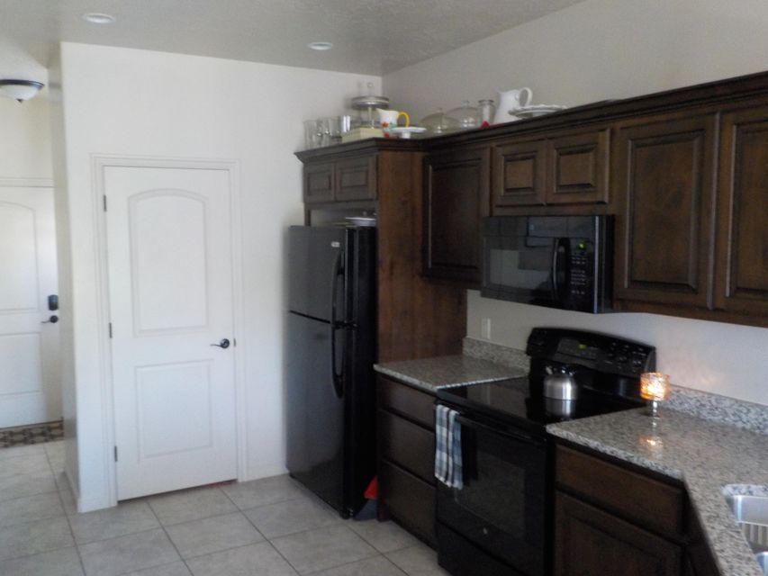 Very Very clean town home in excellent condition.  Great for a young family or older couple.  Location is teriffic and private.  No neighbors on the back and one side. Sellers transfered