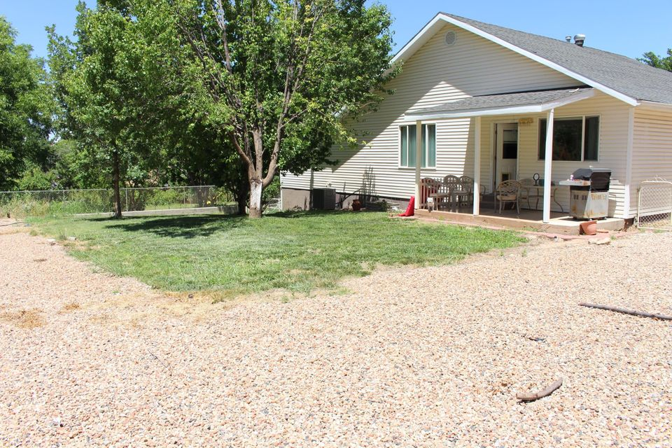 Incredible Find!! 4 Bed/ 2.5 Bath home with basement on .30 acres. RV parking with hook ups. Home features vaulted ceilings, wood & tile floors, upgraded cabinets, walk in shower and more! Open floor plan with family room in basement. Property features incredible mountain views, mature landscaping and fully fenced.