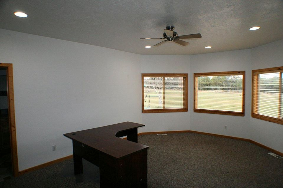 Stunning, self sufficient Mini Ranch plus office and shop in Apple Valley! This property has it all including a beautiful custom home, large attached garage, separate detached workshop, 42X60 detached building that has been used for heavy equipment storage, office space or could be used for visitors. Water comes from a private well located on property, hooked to public power, however all systems