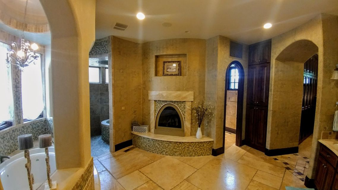 An extraordinary Italian village style mansion built using the finest woods, marbles, granites, plaster, stone & atistry available.  Impressive yet very livable w/lots of private spaces outside of public areas.  Walls of retracting glass bring the almost 1/3 ac. pool to your feet w/beach entry.  Indoor-out door living mastrerpiece is unparalleled.  Indoor climbing wall + $1/4M tree house & pond!