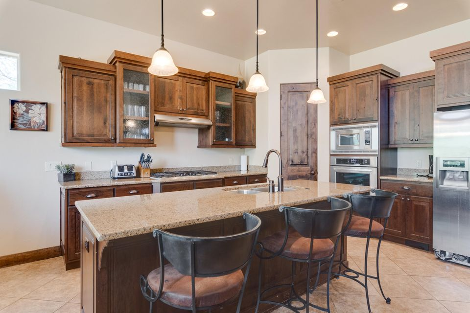 Beautiful 5 bed 3.5 bath property with plenty of upgrades.  Home features 14 foot ceilings and granite countertops thorughout.  Zoned for nightly rental.  Wonderful views from the rooftop patio. Home sleeps 15+ and has had great nightly rental history. Furniture package available.