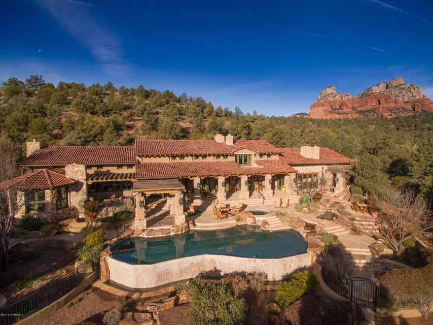 SANCTUARY in SOLITUDE!1st time available & BEST opportunity offered in Seven Canyons!(www.sevencanyons.com)Once featured in PHX Home & Garden magazine.Architectural influences of Mexican Ranch,Old Spain,& Native American cultures combine beautifully w/open floor plan that exudes an Elegantly Rustic style for a buyer of discriminating tastes.Ineffable custom(Phil Morris-Builder/Robert Morris-architect)boasts 11 FP's,infinity-edge pool,2 spas,casita,2 firepits,outdoor living areas,expansive verandas,sweeping views of Red Rock cliffs & the Coconino Nat'l Forest.PLUS adjoining 1.09 ac.lot is included w/home!Tom Weiskopf designed golf course is a welcoming sight to entrance of this prestigious gated community.Come enjoy the unlimited amenities this home and Sedona has to offer!