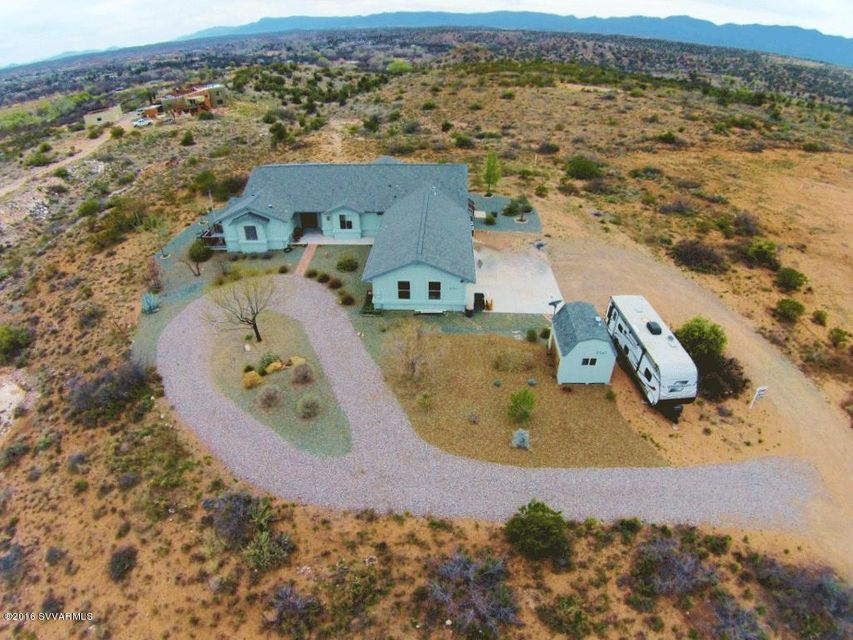Rolling 2.19 acre horse property with unobstructed views of Jerome, Mogollon Rim, Mingus Mountain. Over 1,000SF covered decks, patios & carport. Popular split floor plan provides privacy for owner, guests. Plenty of patios for relaxation. Located between Sedona and Cottonwood, access to communities and shopping couldn't  be better. Great for star gazing in this peaceful and serene area. Immediate access to hiking on forest land, with built-in fire pit and hot tub to relax at the end of the day. Well maintained, natural landscaping with frequent visitors such as, quail, cardinals, rabbits, roadrunners, mule deer, hummingbirds and occasional eagle geese fly over.Master Suite has an adjacent sitting/reading/music room and adds to the ambiance you seek by being in the country, 8 min. to town
