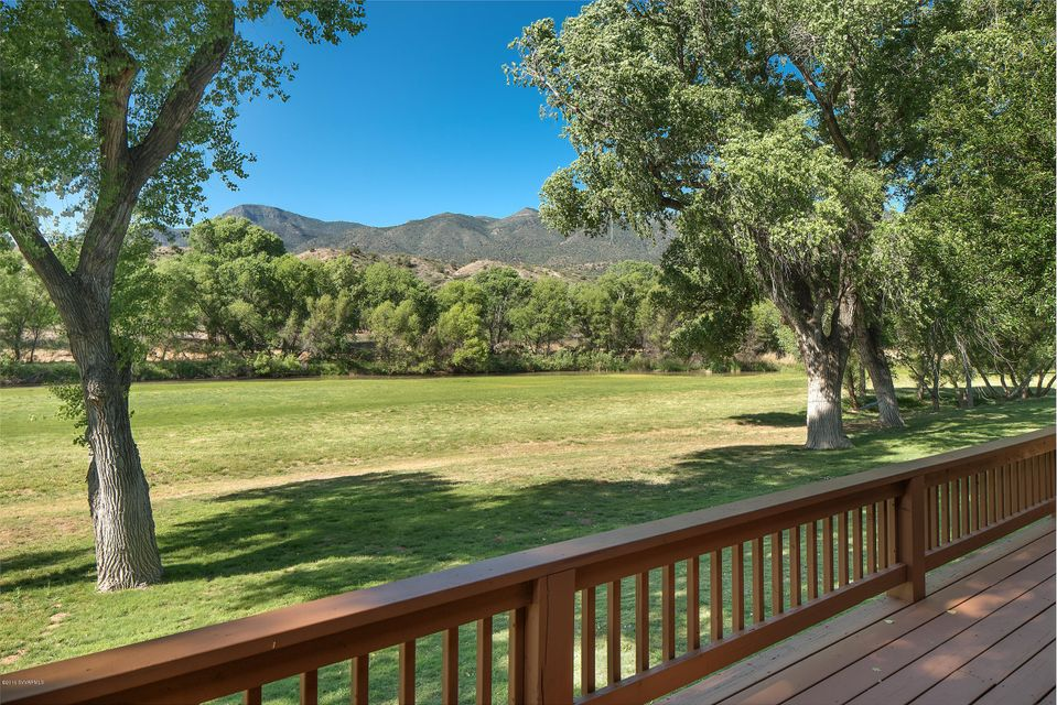 A true equestrian estate with a 2,519 square foot residence and 1,540 SqFt. 3-bedroom guest house an abundance of over 20 acres of privacy on the Verde River, one of the Southwest's last free flowing rivers!  You are only 1 hour 15 min.,  to Phoenix, 30 minutes to the red rocks in Sedona and about an hour to high country, Flagstaff.  This well-manicured supreme property backs to protected US Forest Land.  With ample water for two homes, horses, grazing pastures; orchards of trees and more, these two parcels of land feature 3 wells and ditch irrigation rights.  Horse lovers will appreciate the property's roping arena, an incredibly spacious barn large enough for a car collector's museum and RV parking.