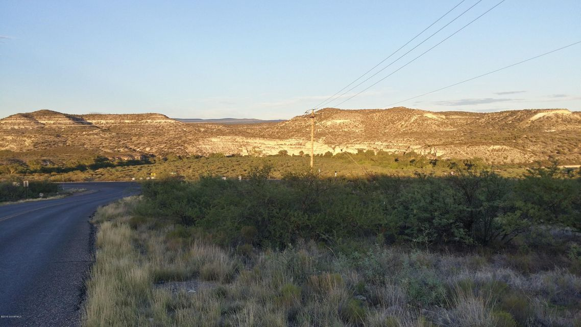 24.98 AC+- Prime Camp Verde Commercial Frontage Parcel. At the intersection of Montezuma Castle Hwy and N Arena Del Loma Rd which has circulation back to Middle Verde Road.  The first corner south of the Cliff Castle Casino heading into town. Subject parcel has frontage on Montezuma Castle Hwy both sides of the intersection.  Elevated panoramic Views that stretch from Montezuma Castle National Monument to the Verde River Valley flowing South abounds from various directions when walking the entire parcel.   This commercial acreage abuts to a proposed 12 lot subdivision ''Castle Heights'' to the NW and a 44.40 acre residential parcel to the East MLS #510744 that can be purchased together.   The commercial zoning is C-2 and allows for diverse usage ranging from residential to commercial.