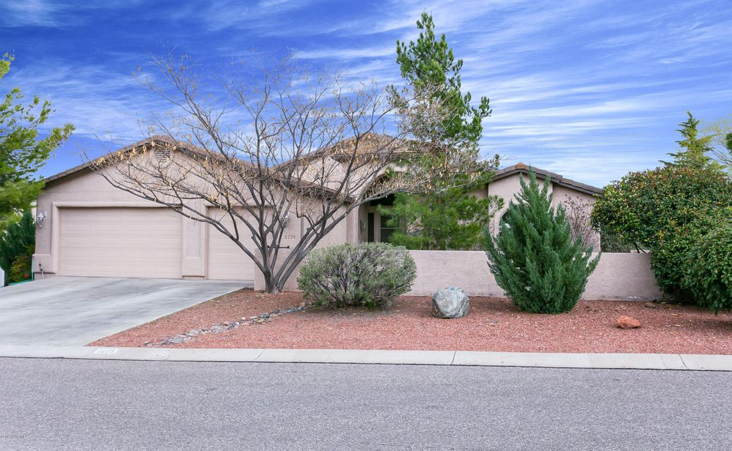 Fantastic location just across from Yavapai College. Over sized corner lot is beautifully landscaped for privacy and fully fenced. Great views from the back patio to Sedona & Sycamore Canyon. The vaulted ceilings help to make this beautiful home open & bright. Granite tile counter tops, and breakfast bar opens to the great room.  Formal dining room has beautiful views and extra lighting.  Each of the bedrooms is oversized with closet kits. The master bath features dual vanities, snail shower & garden tub.  Laundry room is oversized with extra storage. Not many homes with a 3 car garage in this price range. Solar Panels are leased for $160 per month. Seller has not had an electric bill since instillation.  No HOA here, but great neighborhood, close to Oldtown & Jerome.