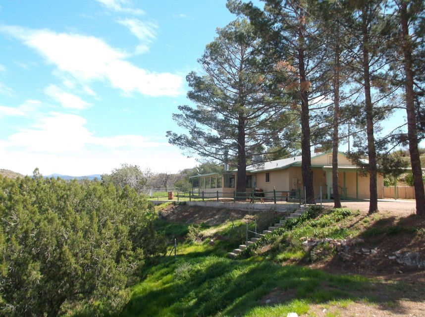 Quiet Country Home on 5.59 acs. with barn and huge air plane hanger. Nice views. Great space for horses and farm animals. No HOA or FEEs.  Located close to Rimrock air strip workshop, well, septic system, Room to roam. 2 Fireplaces- Barn & Horse Pasture. Priced to sell quick! Large Family rm. w/ wet bar.
