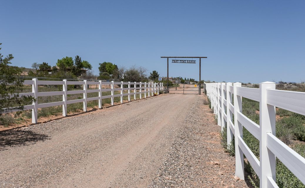 Very private 10 acre horse property & southwest style home backing up to the National Forest with sweeping panoramic views of the Red Rocks & Mountains. The entire property is fenced for horses with access to the National Forest for horse riding & hiking. Property is set up with 3 stall mare motel, paddocks, arena, round pen & walker, 2 wells (one on each parcel), irrigation, RV parking + elec. hook up, basketball court. From the home, relax on the back or front patios to take in the views, sunrises & sunsets. Southwest style home has open floor plan, wood burning fireplace & large windows to enjoy the views, hot tub, split floor plan with large master-suite (shower being replaced with tiled shower), plus so much more!