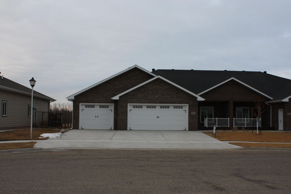 A view like no other in Aberdeen! Custom built, all brick twin home. Energy efficient with 1'' spray foam on both levels, in floor heat in garage and basement. Black stainless appliances are in place.  Blueprints can be viewed under the document tab.
