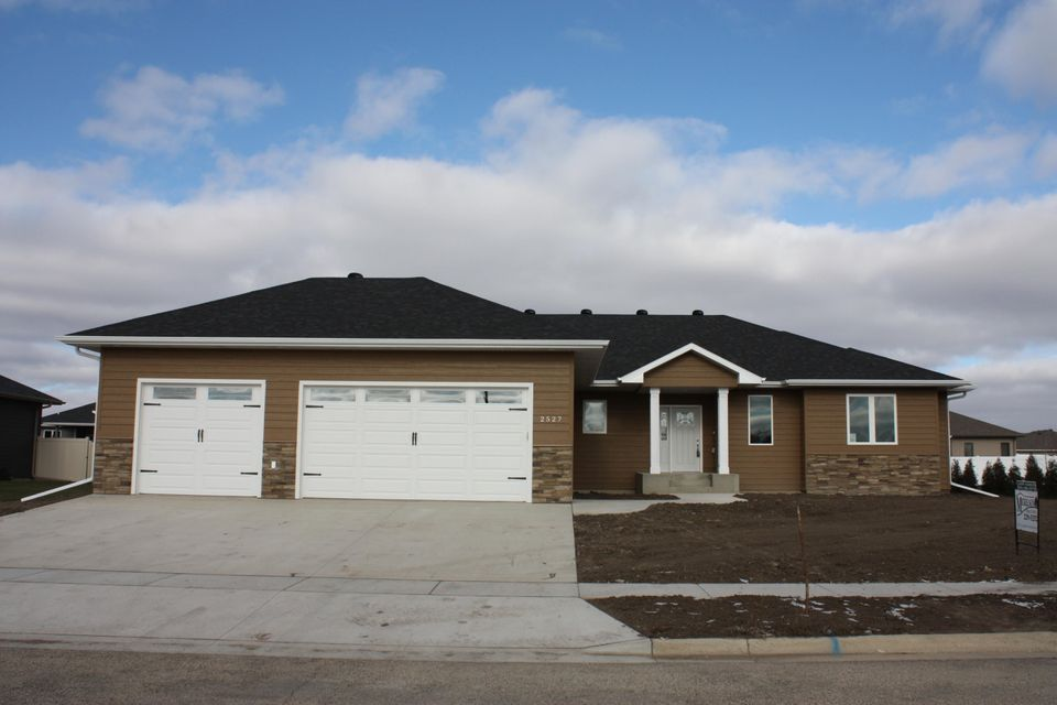 New construction in Prairie's Edge, 4400 sq. ft finished,  5 bedroom, 4.5 bath, office with barn doors in basement, tray ceiling, granite counter tops in kitchen, walk in shower in master bath, fireplace, covered deck. pantry. Wet bar in basement with beverage cooler.
