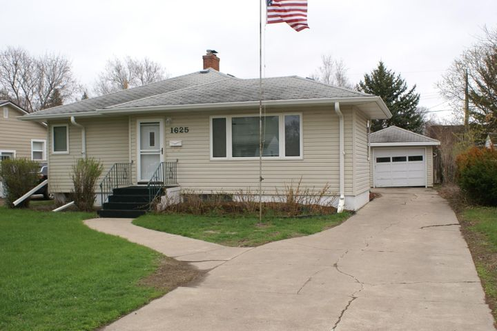Selling in as is condition.  Spacious living room and lower level rec. room.   Hardwood floors in the living room and dining area.