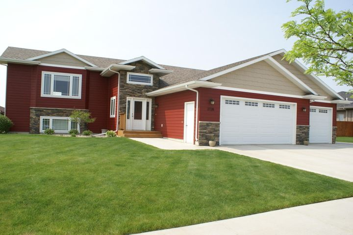 OPEN HOUSE SUNDAY 6-23, 2:30-3:30 PM.A real show stopper in Prairie's Edge.  5 bedroom, 3 bath, vaulted ceiling, all counter tops are granite, surround sound through entire house and garage,  raised panel doors, over sized 3 stall heated garage, covered deck with paver patio and fire pit.  13 zone in ground sprinklers, access to lower level through garage, 14x20 accessory building with concrete floor., concrete pad on side of house.