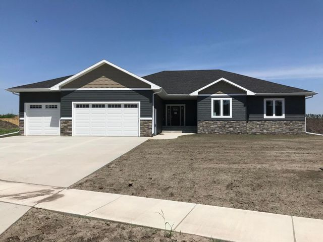 OPEN HOUSE SUNDAY 6-23 2:30-3:30 PM.Stunning contemporary 6 bedroom, 3.5 bath new construction in Prairies Edge.. Open floor plan.  Covered deck, granite counter tops, fireplace, pantry, main floor laundry.  Custom built by Glacier Homes, LLC. 4600 finished sq. ft., with attention to detail.  Schedule your showing now.