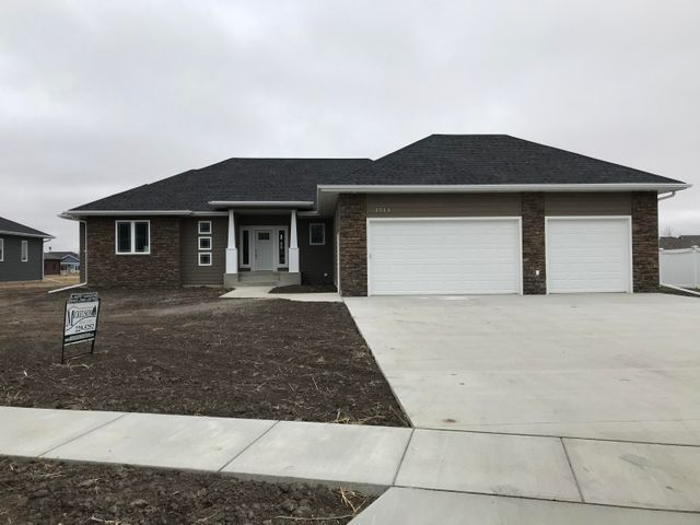 OPEN HOUSE SUNDAY 2-23, 1-2:30Award winning floor plan, newly built custom home in Prairie's Edge Subdivision.  Over 4700 finish sq. ft, 5 bedrooms, 4.5 bath, all main floor bedrooms have a private bath.  Open floor plan, granite counter tops., tray ceiling, fireplace.   Covered  deck, large lot home faces south.