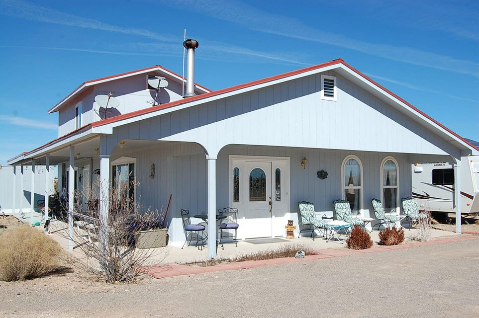 Price Reduced! And an additional 5 acres added to listing. Call Lorraine for more information. - You have a rare opportunity to own an absolutely gorgeous, immaculate, custom home backing to the magnificent panoramic views of the Rio Puerco River & the Ladrone Mountain to the west and the Manzano Mountains to the east. Bring your horses! This lovely, self-sustaining sufficient off-the-grid solar home is on 10 acres & has access to miles of riding trails. Rural, quiet, & perfect for independent living and privacy yet accessible to Belen, Los Lunas, Albuquerque, Santa Fe NM & surrounding areas. Enjoy your very own private country retreat while being within minutes of City conveniences, shopping, the Rail Runner & Interstate 25.