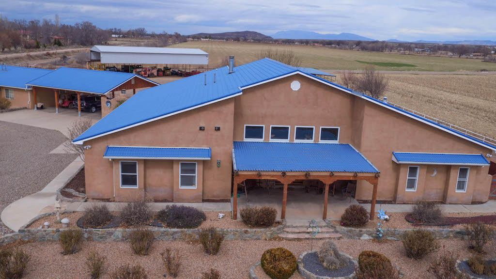 Beautiful Southwest Custom Built Home w/1200 sq ft handicap accessible guest house. Beautiful views in all directions. Oak floors in all main rooms & 14'ceilings w/wood vigas, stain glass accents in some windows, 2 gas log fireplaces, central vacuum, lrg wet bar & many custom features like nichos & built in custom display cabinets. Woodwork & cabinetry are all hand carved. Kitchen is ready for the chef of the house w/built-in processing center, wine cooler, Bosch appliances, Swan Stone countertops, & custom cabinets & many extras. Master suite is also a great get away. Yard w/hookups for RV & gas grill. Outdoor fireplace, huge covered patio & deck. Oversize garage, carport, haybarn & pipe corrals. Bring the horses & enjoy the peace & privacy of this exquisite Estate. Pre-1907water on 19ac