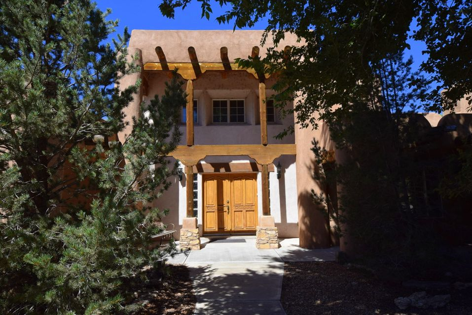 Southwest Charmer! This fabulous 4bd, 2 bath pueblo style home sits on 1 acre with an additional 1 bd, 1 bath casita. Fully landscaped with fountains, sprinklers and bubble drip systems. Main home adorns vigas, nichos and french doors throughout. With a great room and a spacious kitchen, this home has everything you need! Custom bar, dining and additional living area with kiva fireplace are perfect for entertaining! Upstairs is your private master suite with balcony and fireplace. Master bath has separate shower and jetted tub with his and her closets. The 1 bedroom, 1 bath casita is over 800 square feet with a spacious kitchen and bathroom, living room with kiva fireplace, sunroom, 1 car garage and carport. Casita is on its own utilities.