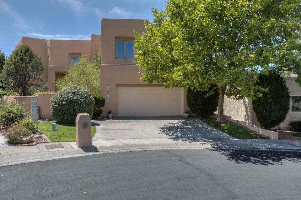 Located in Tanoan- fantastic layout, great views, nicely appointed & tastefully updated! Custom built- by Rich Gantner, this is not your typical Tanoan home. Wood windows, soaring ceilings in the great room, central kitchen opens to family room. Remodeled kitchen has granite countertops, stainless appliances, travertine backsplash & circular breakfast nook w/ exterior access. Upstairs are 4 generously sized bedrooms. Freshly painted- brand new carpet in the bedrooms, new engineered hardwood floors in the living room, dining room & family room! *REFRIGERATED Air* MBR suite has sitting area & spa-like MBA w/ oversized seamless glass shower, custom tile surround, double sinks w/ quartz countertops, soaking tub and glass block accents. Excellent Schools- schedule your private showing today!