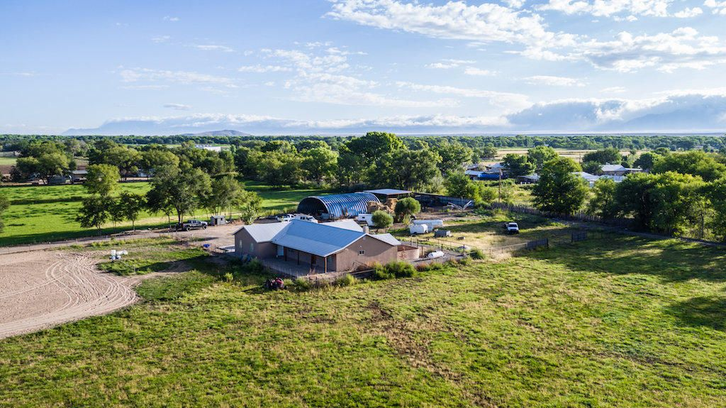 This is a large piece of property totaling 18.47 Acres with a custom home built on it, Large Hay barn, horse stalls, round pens and animal pens. Perfect for the person or family looking for room to ride or even farm as it has lazer leveled land ready to plant and irrigate. (was previously farmed with alfalfa). Custom built home with open floorplan and many extras including tongue and groove ceilings, wood beams throughout, & knotty alder doors. Come see this beauty. More photos to come