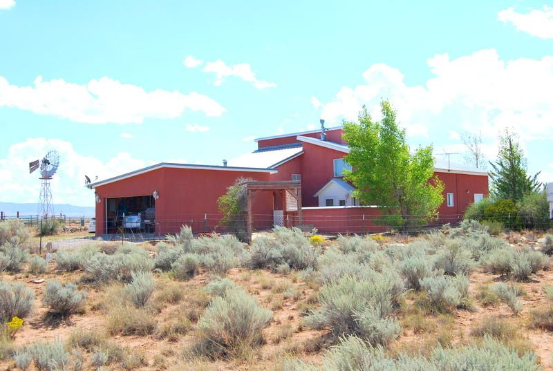 Price reduced by very motivated seller. Expansive views from every window of this handicapped accessible & equipped home. 1st floor is complimented with Aspen wood on the walls & soaring ceilings of the living rm., dining & kitchen. Master bed. 1st floor. Upstairs has a loft /office area, 2nd bedrm., 3/4 bath, plus a sizeable room as storage or play room. Spacious inlaw quarters has 1 bedrm.,walk in closet, full bath, sm. kit.,liv. rm. & separate entry. Ceil fans thru-out, 2 evap. coolers. 2 car attached garage. 500 gal.buried propane. All this on 5.6 ac. set up for horses, 3 stall barn, hay barn, grain/storage shed & wood shed, entire property is not fenced, but ample for animals. Spectacular sunrises & sunsets are to be enjoyed in this peaceful area called Tierra Grande.