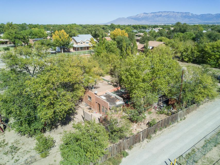 Rare North Valley opportunity just steps from the Bosque trail, Old Town, Downtown & Co-op. Small home sits on 1.22-acre lot. Los Duranes Sector Plan allows for potential of 2 units on property.  Also, there is potential with a zone change to divide the lot into at least 2 and possible 3 lots. Seller can't guarantee these uses. Could be great opportunity to expand or build. Newer homes popping up throughout the area as North Valley lots disappear. Would also be a great urban farm!  County records date the house back to 1939.  3 bedrooms with 1 bathroom, a living room, kitchen and breakfast nook.  Seller has limited information on the home as they have never occupied it and it has always been rented.  Home being sold in ''as is'' condition.  Square feet is not guaranteed.