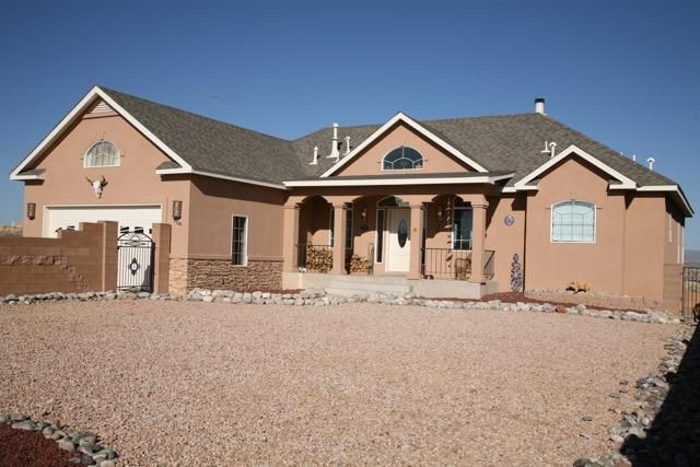 This 4 BR, 2 car garage +768 SF detached gar/workshop custom home with office/study has a place for everyone in your family & all their ''stuff'' too! Situated on a 1/2 acre, A big country porch greets you at the front door. A perfect place for your rocking chairs to sit & watch the beautiful southwestern sunsets. The main level features a great room & a cultured stone FP with tiled banco seating. French doors open to a deck that offers fab Mt. views. A Gourmet kitchen with breakfast nook opens to the great room and formal dining room, featuring a bay window with stunning Mt. views. Master Suite will not disappoint. Laundry room, pantry & office study with built in Alder Cabs finish the amenities on the main level. Lower level boasts large GR area with wet bar, 3 BR & 2 BA, & covered patio