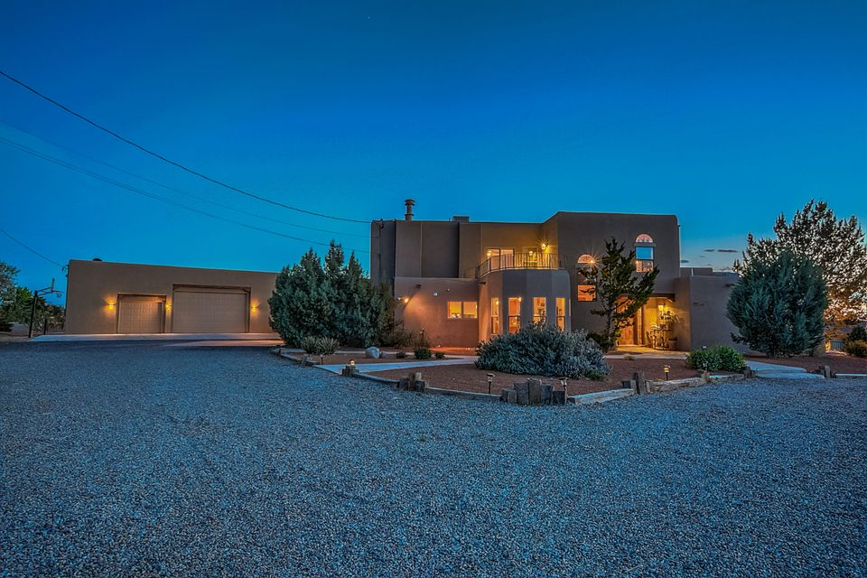 What a Great NAA home, Start with the Open floorplan,2 living areas with wood flooring and a wood burning kiva fireplace. The Gourmet Kitchen features stainless steel appliance, custom cabinets with ample storage, a 7 foot island with granite counters and gas cooktop. Guest bedrooms are on the main level with a extra large Jack and Jill bath. There is also a Powder bath for visiting guests. The 1 acre lot features outdoor living at it finest with a new sparkling blue salt water pool that boasts a 10ft diving area and a 1ft deep beach area,a oversized integrated spa with spillover water fall into the pool, custom rock firepit, trees, grass area, covered patio and entertaining space. The Separate RV garage is 1400sf of room for all the toys, separate garage bath washer and dryer hookups.