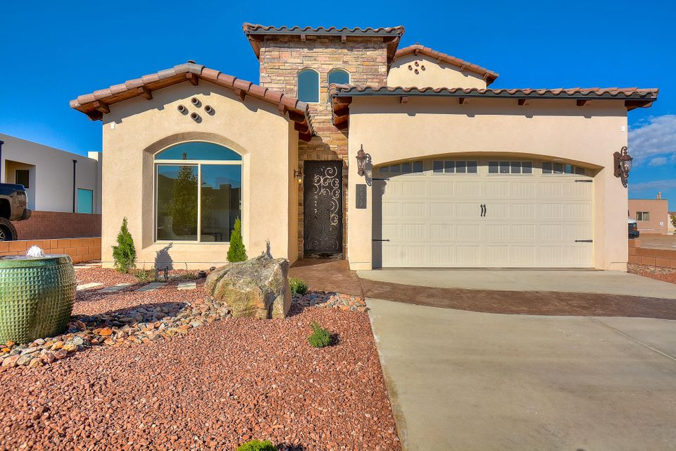 3 Models Homes Open Tue-Sat 11am-5pm and Sun. 1-3pm. Located in North Abq Acres in the newest gated community! Home features 3,350 sf with 5 bedrooms and 4.5 bathrooms. Stunning living area w/ a custom floor to ceiling gas fire place. Beautifully designed open kitchen fit for a chef w/ finely crafted cabinetry, high-end granite counter tops, custom glass backsplash, built in oven/microwave, gas cooktop, range hood, island w/ seating area and more. Imported travertine flooring throughout all wet areas. First floor master retreat with a built-in wet bar and a spa-like bath! Bath features his/hers sinks with custom vanities, built-in make-up area, jetted tub w/ custom surround, walk-in shower w/ two benches and dual shower heads and a walk-in closet w/ built-ins! Balcony w/ jaw dropping view