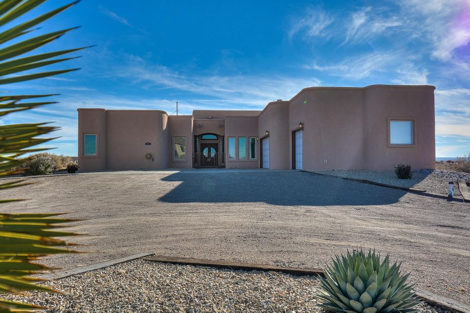 Stunning Cordova Custom Home located on a large 1/2 acre lot in the heart of Rio Rancho! This spacious home features 4,317 sf w/ 5 bedrooms, 4 baths, 2 living areas, an office and a 3-car garage! Gourmet kitchen w/ high-end cabs/crown molding, granite countertops, built-in double oven, microwave, cooktop, LG Fridge, center prep island, pantry & built-in desk/mail area! Gorgeous main living area w/ raised coffered ceilings, hardwood flooring & an amazing fireplace! JR suite w/ private bath. Beautiful master suite w/ hardwood flooring, a romantic 2-way fireplace, outdoor access w/ patio & a spa-like bath! Bath hosts his/hers sink w/ custom vanities, large jetted tub w/ mountain views, walk-in shower & private dressing area! Deck w/ hot tub overlooking the Sandia Mountains! This is a must see