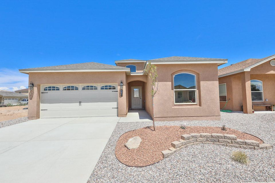 Custom built home in the heart of Los Lunas. The front yard landscaping and covered patio welcome you into the Bayuda Floor plan. This Home is very spacious & open. The elegant fireplace is a great focal point. The kitchen with custom cabinets and designed tiled back splash & upgraded appliances including stove, dishwasher, and microwave range hood. The bar perfect for serving children and those family gatherings. Master suite has private bath with double sinks, garden tub/shower with tile surround and large walk in closet. Large family room with vaulted ceiling. A must see, call for your private showing today... Open House daily from 9am to 5pm. Photos may be from other homes to show flexibility with features.