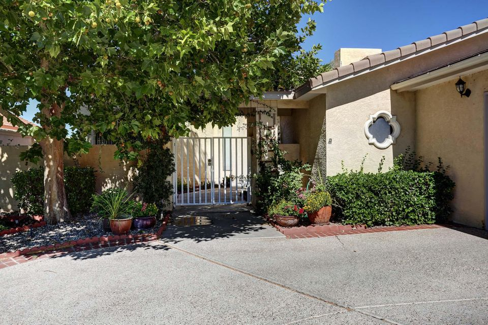 Exquisite custom 4 BR one story home in the exclusive Broadmoor area of Tanoan with panoramic views of the golf course, mountains & park from private deck. Brazilian hardwood floors add a luxurious touch as well as the granite counters in kitchen & remodeled baths. Newer under mount sinks in master & main bath (new tile surrounds)Office/bedroom area offers jack & jill bathroom with vessel sinks updated tile surrounds and jetted tub. Enjoy those elegant dinners in a stately dining room. Fireplaces in both living areas add to the overall warm feeling in this home. Recently added in-wall vac system, recessed lights, hot water heater, covered patio, lovely landscaping and tile warmers in all baths. Special Financing Incentives Available on this property from SIRVA's preferred lender.