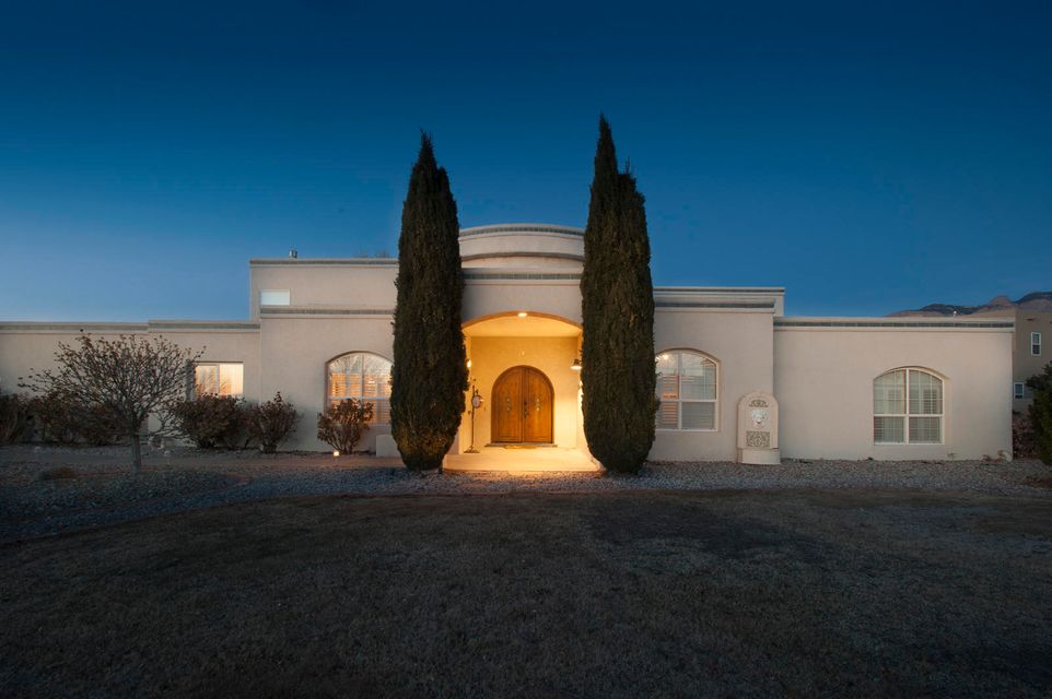This is a well kept, spacious, beautiful and functional home.  Located in the desirable North Albuquerque Acres and the best school district, this house offers 4 spacious room plus an office, an open kitchen, beautiful views, 4 car garage, and a hobby room (not included in the square footage), and so much more.  Please come and see for yourself.