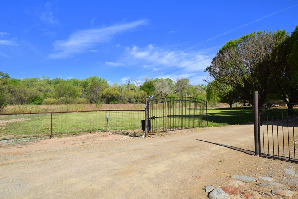OPENHOUSE- Sunday 4-15-18 from 2 to 4 Beautiful 4.58 irrigated acres with a one level fabulous home! Personality, angles, high ceilings,concrete floors, & high ceilings throughout. Open, yetdefined living areas, natural light, perfect for entertaining both inside & out.  Property is private & backs up to ditch w/bosque & trail access. Courtyard entry, spacious living, dining, a true chefs kitchen w/commercial stove, & wonderful MBR w/sitting area, FP, walk in closet, oversized shower. Other 2BR are separate w/ jack & jill BA. Guest bath, laundry room & 3 car garage plus. An oversized west portal w/BBQ to enjoy the wide open space. Mature willow trees, oak trees, & the park like setting make this property very special. Pipe fencing, pasture, all ready for your barn, arena & country living