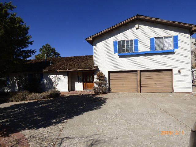 This home is located in an amazing area, with great views of the mountains! This is situated on 1 acre of land. This fixer upper could be a great opportunity for that homeowner wanting some sweat equity, Or for that savvy investor. Check out the values in the area to appreciate the price.