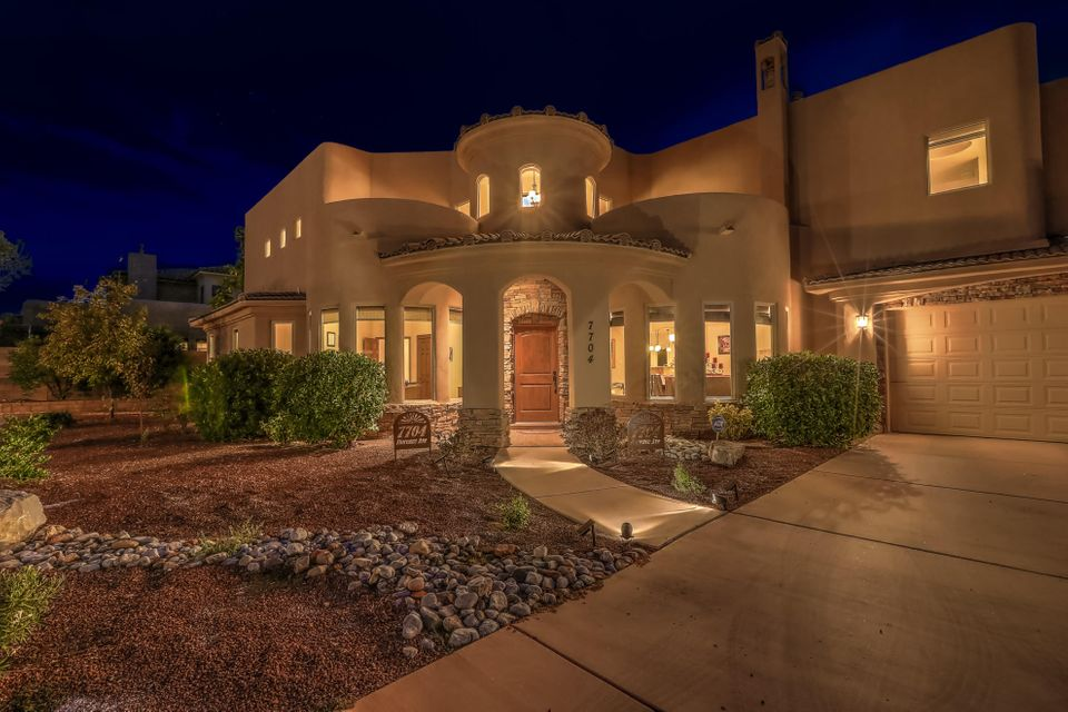 Tucked quietly on a cul-de-sac, this custom home is the picture of luxury and the newer solar ensures this beautiful, sizeable home is also energy efficient. The great room features soaring ceilings, custom kiva fireplace, hand-scraped wood floors, and custom plaster finishes. The Chef's kitchen with custom cabinetry, high-end appliances, granite, custom tile, and a large pantry is situated off the great room and dining room. Upstairs master suite is your private escape with a spa-like master bath, sunset & mountain views, as well as access to the covered deck with panoramic views of the city. A second master is located on the main floor with private access to the lush but low maintenance backyard and covered patios. The 5 well appointed bathrooms accent the 4 spacious bedrooms perfectly.