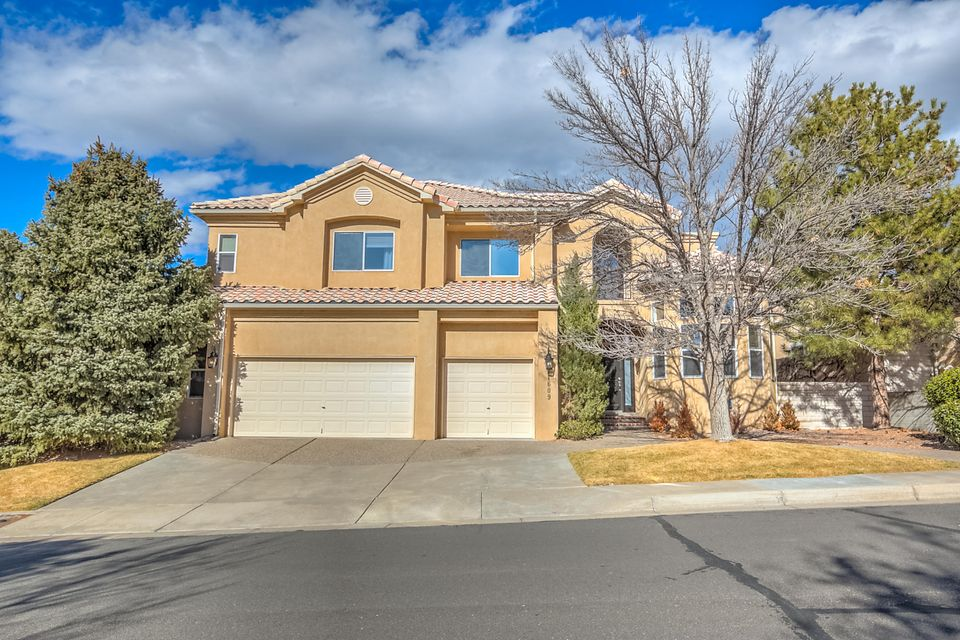 Welcome to this fabulous home in the Tanoan gated community. Move-in ready and waiting for a new owner, the main level features 2 living areas both w/ beautiful fireplaces, hardwood floors, large windows w/amazing views of the Sandia Mnts, private office with built-in shelving (could be 6th bedroom if needed), formal dining room, spacious kitchen with double ovens, granite counters and lots of cabinet storage. Don't miss the finished basement w/ bedroom, bathroom, living area or game room. Upstairs has 4 bedrooms and beautifully updated bathrooms. The luxurious master suite incl. fireplace, sitting area, walk-in closet, garden tub, private balcony w/mnt. views and more. For a quiet retreat, the backyard has large covered patio and backs to private green area. Call for showing today.