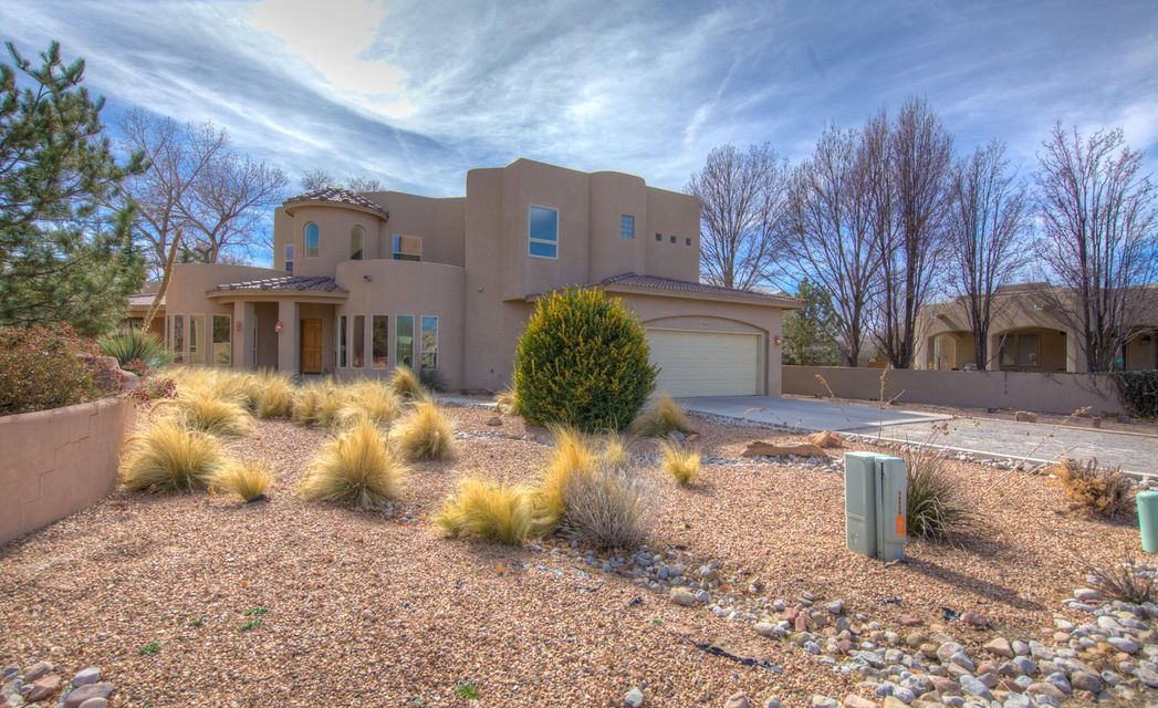 Beautiful north Valley home. Enjoy this 4 bedroom 2.5 bath home. Open with lots of natural light. Great room open to kitchen and formal dining. Huge kitchen with Silestone counter tops SS appliances , pantry. Radiant flooring. 3 spacious bedrooms down and extra large master suite with reading area and office area. Big walk in closet. Large wrap around deck for master suite.  Close to Montano and Coors walking paths & Bordering Los Poblanos Open Space.