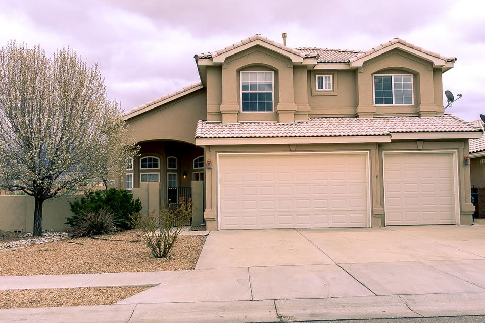 OPEN HOUSE SUNDAY 3/18 1:00 - 3:00. Gorgeous home located in Desert Ridge trails sub division with breath taking views of the Sandia Mountains. This five-bedroom home is in the La Cueva district. This home has been freshly painted and includes an attached three car garage, a pitched tile roof, custom gas log fire place, gas and electric washer dryer hook ups. An extra-large master bedroom with a balcony overlooking the mountains. Spa like master bath with garden tub, double sinks, built in shelves in the walk-in closet. Cathedral ceilings with ceiling fans. Two living areas with a formal dining room. Carpet and tile throughout. Refrigerated air. Covered patio with a built in outside storage and a lovely gazebo off the covered patio. This house is going to fly of the market!