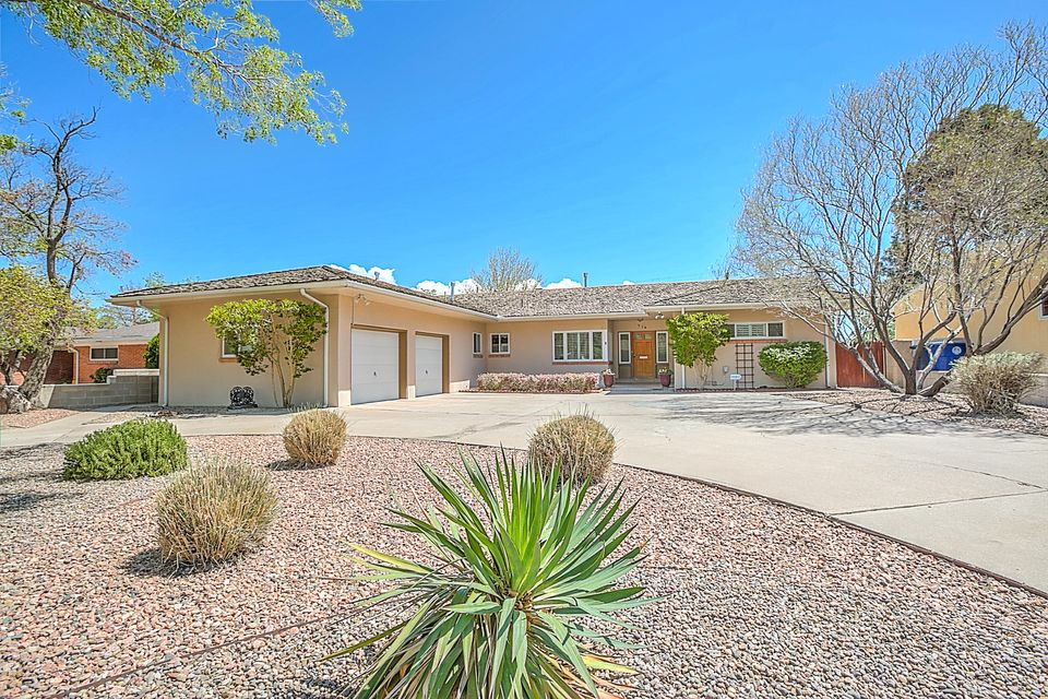Picture Perfect, this home could be featured in a magazine! Classy updated UNM/Ridgecrest with retro flair- this single level home- has 3 bedroom, 3 bathrooms, 2 living spaces, formal dining room + pool! Gleaming hardwood floors, fully remodeled kitchen with granite countertops, stainless steel appliances, plantation shutters, vaulted ceilings, REFRIGERATED air, large secondary bedrooms. Generously sized master bedroom has double closets and built-in storage & access to the backyard. Plenty of parking with 2 car garage and pull through driveway! Expansive open & covered patio, in-ground gunite pool with safety cover, grass area with play-set! Oversized laundry room, garage has epoxy floors and storage!